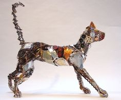 Fish Eye The Alley Cat sculpture. --Barbara Franc is a very creative sculptor and passionate about creating masterpieces using different forms of wire and most of the time uses discarded metal, junk, or any found object.