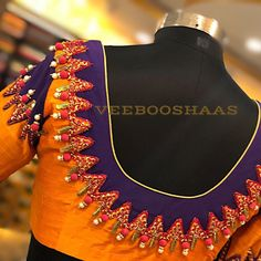 Beautiful orange and blue color designer blouse with unique design hand embroidery work. FOR ORDERS AND APPOINTMENTS CALL ON +91-99441-33022. 21 May 2018