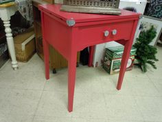 Sewing Table re-purposed into entry hall table. Fun red paint color! By Earth Exchange, Maple Grove, MN http://www.earthexchange.org