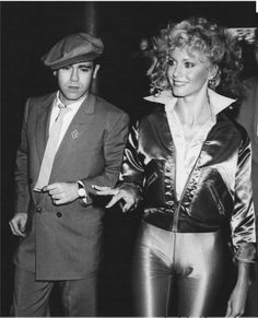 Elton John + Oliva Newton-John at Studio 54, opening night party for Grease. Her colour palette: electric blue pants, hot pink shirt, red jacket. He wore a blue suit and pink tie to match.