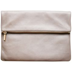 Zipper accent clutch becomes a crossbody handbag with included strap. US made from Italian leather.