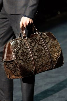 Carpet bags appearing in the Milan Menswear shows - this one from Louis Vuitton