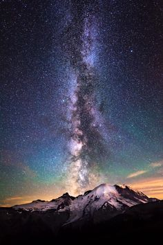 Millions of stars erupt in the night sky over Mount Rainier National Park, creating this dazzling pic of the Milky Way and Washington's iconic mountain. Photo courtesy of Kevin Shearer. — with KDS Photography at Mount Rainier National Park.