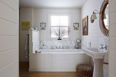 "[i]White bathroom with marble detail[/i]  Like this? Then you'll love  [link url=""http://www.houseandgarden.co.uk/interiors/bathroom""]Bathroom Ideas[/link]"