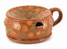 """Realized Price: $ 2607   Pennsylvania redware spittoon, 19th c., signed Adam We, with green oxide and slip dot decoration, 2 1/2"""" h., 4 1/2"""" dia. The Collection of Lester Breininger"""