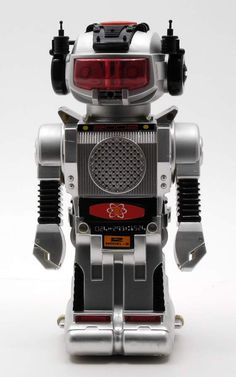 "One of my favorite toys as a kid. When you push the red button on his head, he says, ""I am the atomic powered robot. Please give my best wishes to everyone!"" It came with a little bottle of oil, and if you put a few drops into the hole in his head, smoke would come out of his mouth."