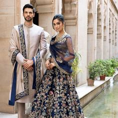 On him - A moon grey raw silk sherwani worn with a tassar silk shawl On her - Our mood blue resham &… Couple Wedding Dress, Wedding Dresses Men Indian, Indian Bridal Outfits, Indian Bridal Fashion, Indian Bridal Wear, Indian Gowns, Pakistani Bridal, Pakistani Wedding Outfits, Punjabi Wedding