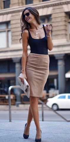 #winter #outfits black scoop-neck sleeveless shirt and brown midi skirt
