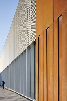 Library influenced by Newcastle's ship-building heritage featuring oxidised-steel walls.