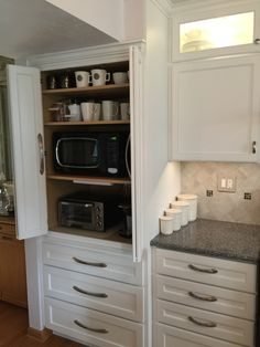 Appliance cabinet. Great to hide microwave, toaster oven, coffee maker.