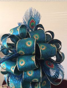 Check out this item in my Etsy shop https://www.etsy.com/listing/254639850/peacock-tree-topper-christmas-bow