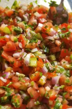 """Salsa   """"This is the quintissential salsa recipe. The cool tomatoes contrast nicely against the spicy jalapenos and pungent onion, and the lime juice and salt round out the flavors nicely. Let it sit overnight to really let the flavor develop."""" #footballrecipes #gamedayrecipes #tailgatingrecipes #superbowlrecipes #superbowlparty #superbowlpartyideas"""