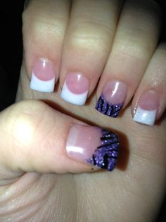 White and purple nails with black zebra print.
