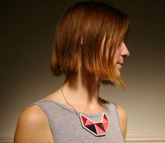 Small embroidered geometric bib necklace in beautiful pinks oxblood red and dark blue by AnAstridEndeavor on Etsy https://www.etsy.com/listing/125387755/small-embroidered-geometric-bib-necklace
