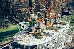 The wild setting for a wedding table.  The white against nature.  Beautiful. As seen on The Wedding Vault. Makeup and Hair Storme Webster, Storme Makeup Model Eve Ainsbury Venue Danesfield House Photographer Kitty Wheeler Shaw Dress designer Jessica Turner Designs Jewellery and Hair Pieces Beverly Pile, PS With Love Florist Eram Khan, Boom Blooms Cake Kate Roche Lieberman, Dolce Lusso Cakes Stationery Holly Rees, Holly Rees London Tableware Daniela Johnston, Classic Crockery
