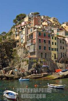 Colorful historical houses in the small coastal village Riomaggiore at the Ligurian coast , North West Italy . stock photo