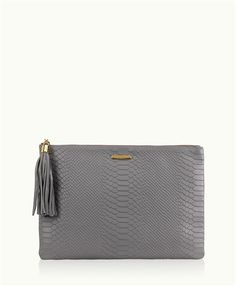 To compliment your chic style, this slim yet voluminous clutch can fit more then you would think!