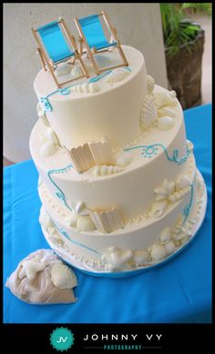 CAKE: Already ordered. Marble cake with passion fruit filling, candy seashells, and buttercream icing.