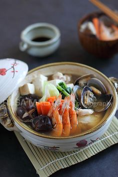 Anything Goes Hot Pot - Chicken, mushrooms, Napa cabbage, Tokyo negi, tofu, and assortment of seafood of your choice: head-on shrimp, scallops, oysters, fish fillet, clams, etc. #seafood #soup