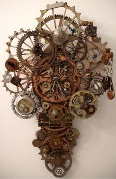 Steampunk Clock - Erin Keck... I'm going to have to steampunk me out a star...!  This almost looks like a cross,