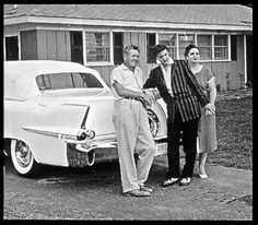 Vernon, Elvis and Gladys in front of their new home on Audubon Drive, May,1956.