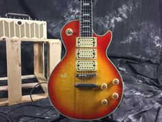 Ace Frehley Budokan. Like it? Get it here: https://www.aliexpress.com/item/10S-Custom-Shop-Ace-Frehley-Budokan-Aged-and-Signed-Electric-Guitar-Heritage-Cherry-Sunburst/32729790753.html