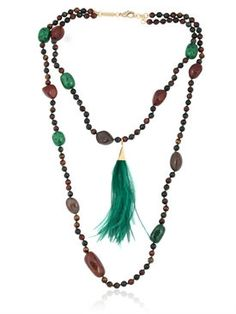 Gold plated brass details . Malachite. Crystals . Carved purple resin . Carved magnesite Buddha heads. Beaded tassels . Any variation in color or detailing is a result of the handcrafted nature of this item and makes each piece unique.