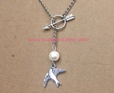 The Hunger Games Inspired ARROW, Mockingjay, Peeta's Pearl SILVER necklace----Lariat