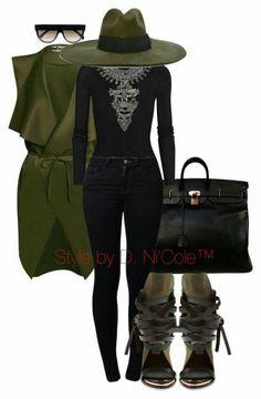 Green cardigan, green shirt, black shirt, black pants, green shoes, black purse.