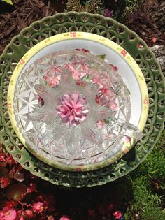 Beautiful fancy green back plate with yellow and pink accents and special pink ceramic center flower. MiMi's Plate Flowers