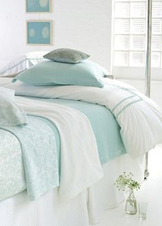 lovely white linens and cool coastal blues in the bedroom