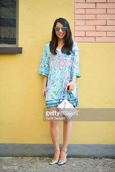 Yuwei Zhangzou poses wearing a Roberta Einer dress and Kenzo bag before the Antonio Marras show during the Milan Fashion Week Spring/Summer 16 on September 26, 2015 in Milan, Italy.
