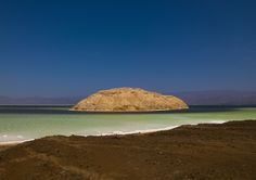 Lake Assal, aka the honey lake  is a crater lake in Djibouti. It is located in the Gulf of Tadjoura, at the top of the Great Rift Valley. It is a saline lake which lies 155 m below sea level, making it the lowest point on land in Africa and the 3rd lowest land depression on Earth after the Dead Sea and Sea of Galilee. Lake Assal is the world's largest salt reserve, which is presently exploited by companies. Very few camle caravans still come to bring back the salt in Ethiopia in the remote…