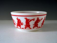 "Hazel Atlas childs dish with red fired on ""Looney Tunes Pigs"" over white translucent platonite, made ca. the 1930s. It's from the Hazel Atlas ""Kiddie Ware"" line."