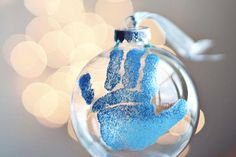 This DIY Christmas ornament adorably features the hand print of your baby. #christmas #craft