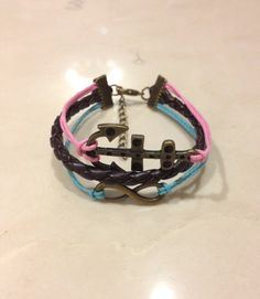 Brass Infinity & Anchor Charm Bracelet. It looks bronze, pink, and blue to me too! Infinity Anchor, Anchor Charm, Delta Gamma