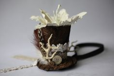 Brown paisley pattern mini top hat with cream antler horns. This particular hat is really tiny (so cute)!