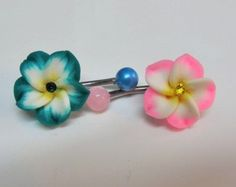 Belly piercing ring with your choice of 6 colors of Hawaiian plumeria flower with color matching Swarovski crystal center in 14 or surgical steel.>>> I love tjis but I could never get my belly button pierced. I hate people touching my stomach. Belly Button Piercing Rings, Bellybutton Piercings, Belly Button Jewelry, Cute Piercings, Belly Rings, Body Piercings, Ear Gauges, Nose Rings, Jewelry Tattoo
