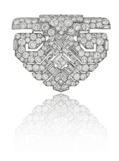 A Magnificent Platinum & Diamond Art Deco Clip by Cartier, London, circa 1930