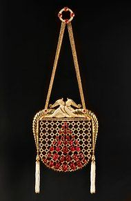 Jeweler Stefano Canturi was commissioned to create a clasp bag based on an Erté  illustration made for a George White's Scandals revue in the late 1920s. The bag is made with 3,978 diamonds, 63 sapphires and 43 rubies. The cost is $780,000.