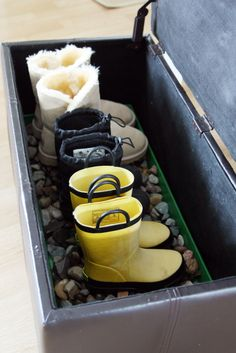 Great way to store winter boots - the plastic tray and rocks lets the snow melt away without creating puddles!