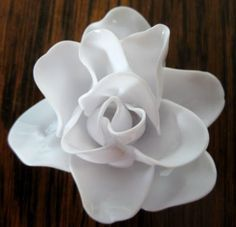 """Porcelain"" rose from recycled (melted) plastic spoons - Cool idea and pretty result. Just watch those fumes, do it outside!"
