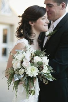 So pretty, just the slightest hint of pink and red, combined with soft green ferns and pine creates a lovely #winter #wedding #bouquet