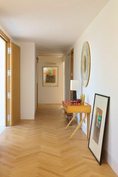 The entrance hall and passage with the herringbone oak parquet flooring.