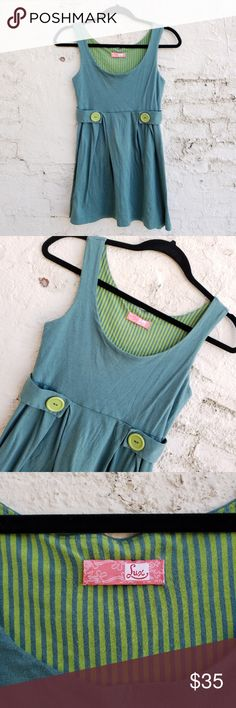 """{Lux} summery pinafore schoolgirl dress. Sweet little dress that has the feel of my childhood in the 1970's.  Lux is a brand carried by Urban Outfitters. Soft and light 100% cotton, feels like brushed jersey. Light dusty teal color with lime accent buttons at wraparound waist (decorative only). Scoop neck, wider tank straps, waist seam falls almost at empire level. Great by itself, or with a tee underneath.  TAGGED SMALL, FITS XXS, XS BEST.  LENGTH; 28"""" SHOULDER TO HEM. BUST: 29"""" AT…"""
