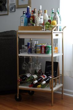 I knew when I moved into my new apartment, a bar - or a bar cart, at the very least - would be a much-needed addition to my space. IKEA bar cart hack it is! Ikea Bar Cart, Diy Bar Cart, Gold Bar Cart, Bar Cart Decor, Bar Carts, Revere Pewter, Apartment Interior, Apartment Living, Apartment Kitchen