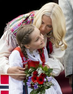 Crown Princess Mette-Marit of Norway and Princess Ingrid Alexandra greet the Childrens Parade on the Skaugum Estate on May 17, 2014 in Oslo, Norway.