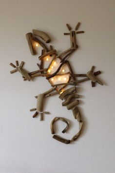 Driftwood Lizard mounted on a canvas with LED lights / Driftwood Art