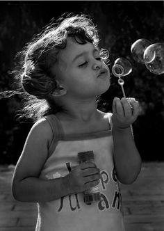 """The Little Bubble Blower"".   - (http://i643.photobucket.com/albums/uu151/95479403/Bubbles/11.jpg)"