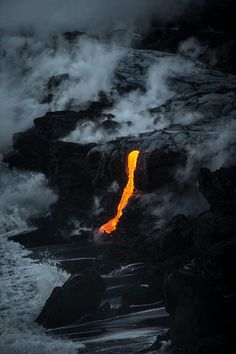 Lava running down off the volcano and onto the shore